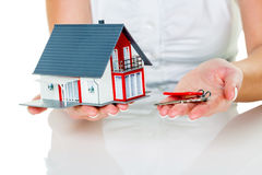 Real estate agent with house and key. An agent for property with a house and a key. successful leasing and home sales by real estate agents Stock Photo