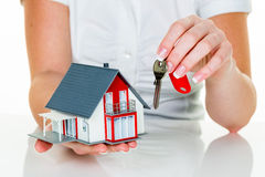 Real estate agent with house and key Stock Images