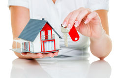 Real estate agent with house and key Stock Photos