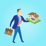 Real estate agent with a house model for sale. Vector illustrati Stock Images