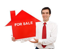 Real estate agent with house shaped sign stock photography