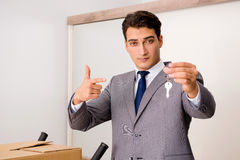 The real estate agent with key from new house Royalty Free Stock Image