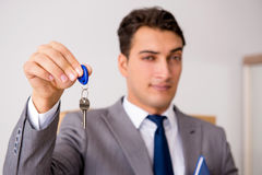 The real estate agent with key from new house. Real estate agent with key from new house Stock Photos