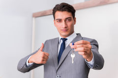 The real estate agent with key from new house Royalty Free Stock Photo