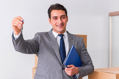 The real estate agent with key from new house Royalty Free Stock Photography