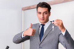 The real estate agent with key from new house. Real estate agent with key from new house Stock Image