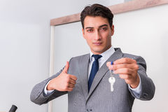The real estate agent with key from new house Stock Photography