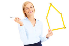 Real estate agent with keys and measure Royalty Free Stock Photography