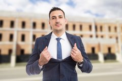 Real estate agent manager showing chest as power and success con stock photos