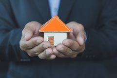Real estate agent offer house. Property insurance and security c royalty free stock image