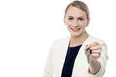 Real estate agent offering new house key Royalty Free Stock Image