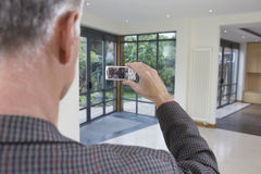 Real Estate Agent Photographing New Property Stock Photo