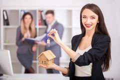 Real estate agent portrait with family getting new home. business concept about real estate market stock image