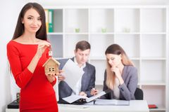 Real estate agent portrait with family getting new home. business concept about real estate market.  royalty free stock photo