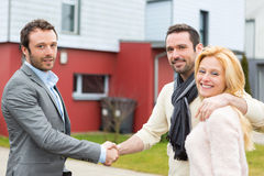 Real estate agent present house to a young Royalty Free Stock Photography