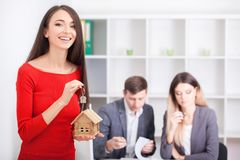 Real estate agent presenting a contract for house investment to Stock Photo