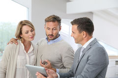 Real-estate agent presenting futur home to clients Royalty Free Stock Image