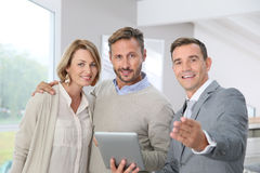 Real-estate agent presenting new home to clients stock images