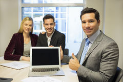 Real-estate agent presenting a new project on laptop, young coup Royalty Free Stock Photos