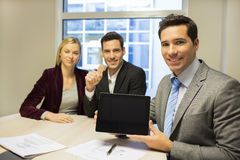 Real-estate agent presenting a new project on tablet pc, young c Stock Photography