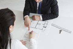 Real estate agent prompting to sign to contract Stock Image