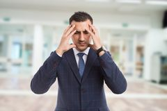 Real estate agent or realtor suffering head pain royalty free stock image