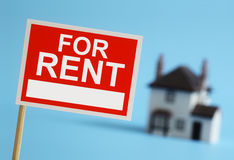 Real estate agent for rent sign. With house in background Royalty Free Stock Photo