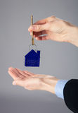 Real estate agent's hands holding a key. From a house, closeup shot Royalty Free Stock Photo