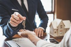 Real estate agent Sales manager holding filing keys to customer royalty free stock photo