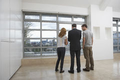 Real Estate Agent Showing Couple New Apartment royalty free stock photography