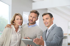 Real-estate agent showing couple their new appartment royalty free stock photos