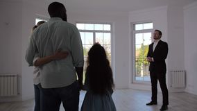 Real estate agent showing family room in house stock video footage