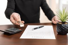 Real estate agent showing house keys. After contract signing royalty free stock images