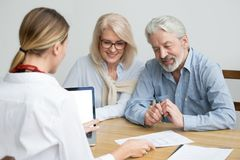 Real estate agent showing house plan consulting aged senior coup royalty free stock photos