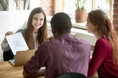 Real estate agent showing house plan to multiethnic married coup stock images