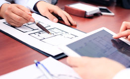 Real-estate agent. Showing house plans on electronic tablet Stock Photography
