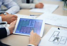 Real-estate agent showing house plans Stock Photography