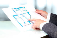 Real-estate agent showing house plans to a businessman. Stock Images