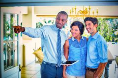 Real estate agent showing house to couple royalty free stock photography