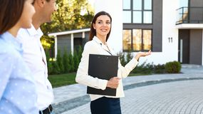 Free Real Estate Agent Showing House To Young Couple Royalty Free Stock Images - 163001779