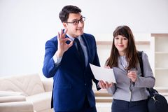 The real estate agent showing new apartment to owner. Real estate agent showing new apartment to owner Stock Photos