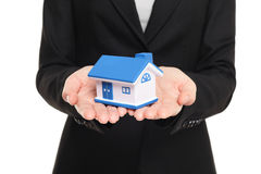 Real estate agent showing new house in mini size. New home owner concept. Realtor showing holding house model. Buying new home conceptual image with business Royalty Free Stock Images