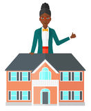 Real estate agent showing thumb up. Royalty Free Stock Photography