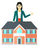 Real estate agent showing thumb up. Royalty Free Stock Images