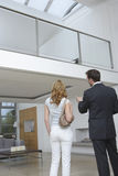 Real Estate Agent Showing Woman New House Stock Image