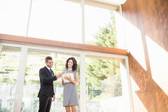 Real-estate agent showing young woman new home Stock Image