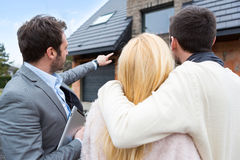 Real estate agent shows details to customers Stock Images