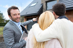 Real estate agent shows details to customers Royalty Free Stock Photos