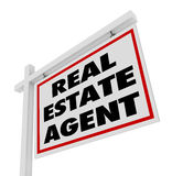 Real Estate Agent Sign Advertising Agency. The words Real Estate Agent on a home or house for sale sign advertising an agency and its professional services aimed Stock Photos