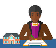 Real estate agent signing contract. Stock Photos